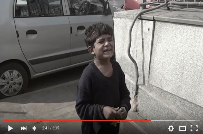 This street boy can't contain his excitement after getting the first 'Happy Meal' of his life