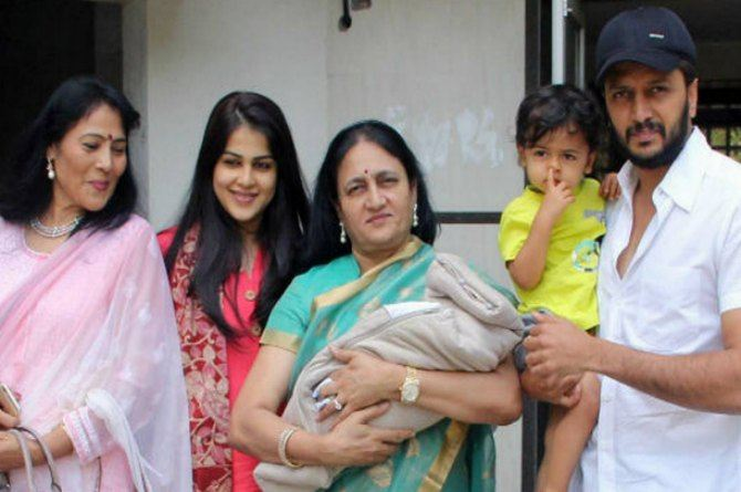 The first pics are out! Genelia and Riteish take the baby home; brother Riaan watches on!