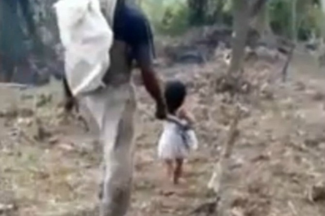 This five-year-old girl walks her blind father to work every day