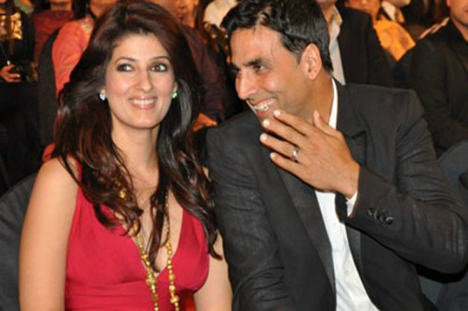 Akshay Kumar and wife Twinkle share a light moment at an event.