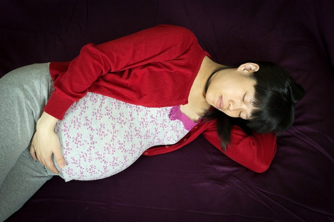 Sleeping on your back during pregnancy might increase the risk for stillbirth