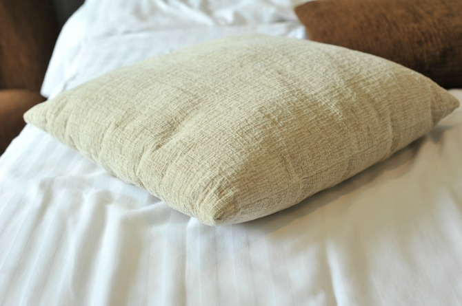 Lying with a pillow under your hips