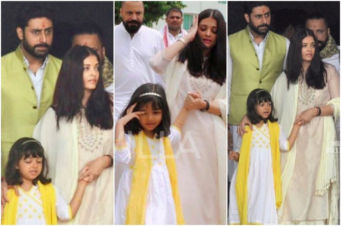 Aishwarya and Abhishek travel to Allahabad to immerse Aish's father's ashes