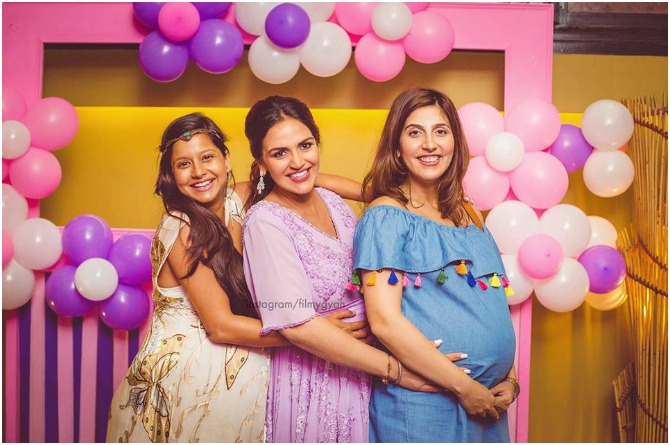 Friends and family gather together to wish the glowing mum-to-be