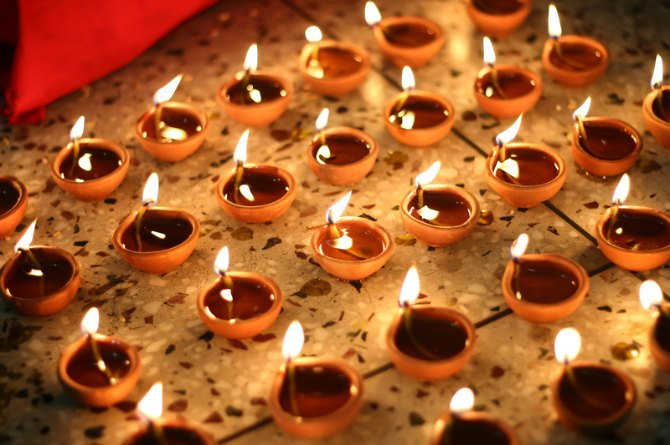 Why do we light lamps during Diwali?