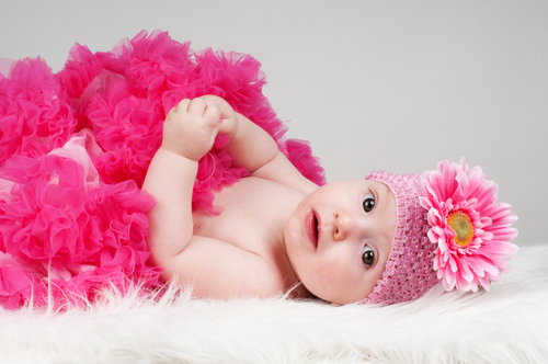 baby in pink flower headband